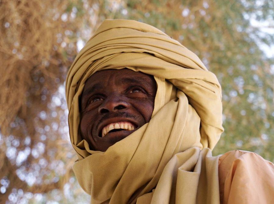 Reise in Tschad, gute Laune im Guelta